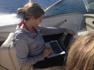 This is me, on our family vacation last year, finishing my second book proposal, due that day, while my 10 year-old daughter drove the boat (in my husband's lap) back to the dock so I could email it out! Talk about too busy.